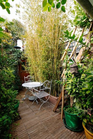Lush vegetation on the terrace. Enjoy exterior in the top of the city