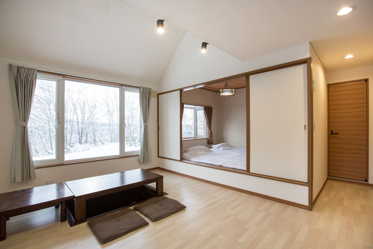 Open kitchen, dining and tatami room; tatami room doubles as a lounging area with bean bags and a low level table