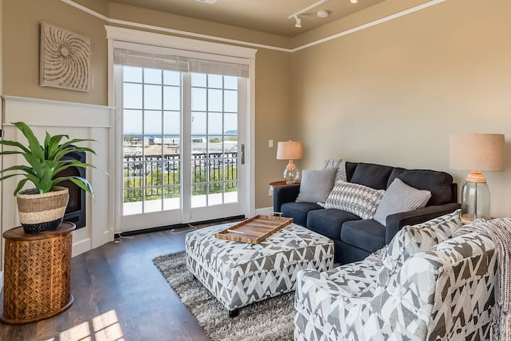 A spacious common area with views of Drayton Harbor. The couch folds out to a second bed.