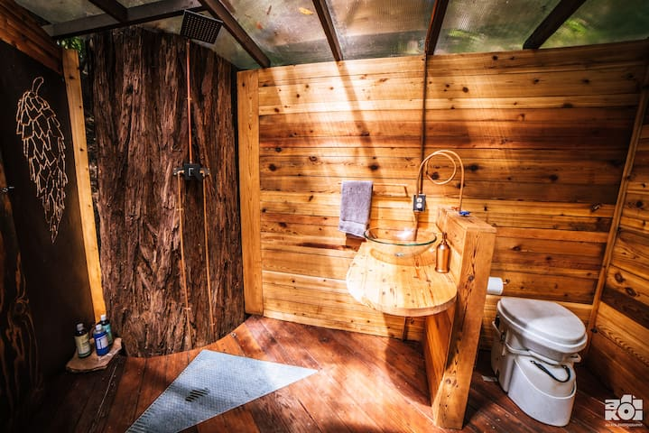 Open air shower, gravity fed sink and composting toilet.
