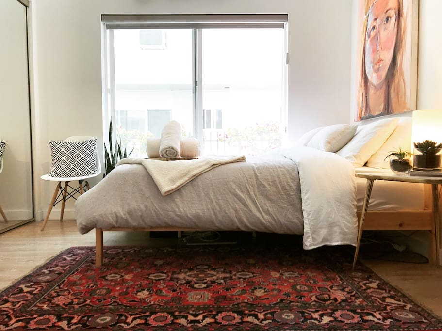 Private bedroom comes complete with a tempurpedic mattress topper and a gorgeous hand woven Parisian rug! The light in this room is magic!