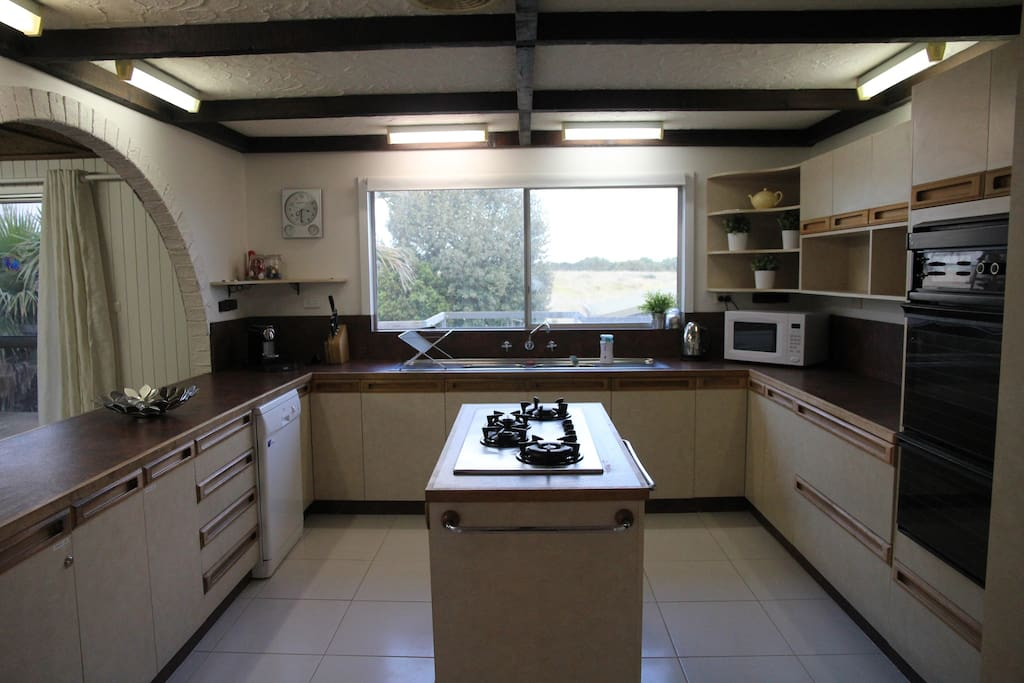 Large spacious fully self contained kitchen, with Electric oven, Gas cook top, microwave and dishwasher. Coffee pod machine with pods included.