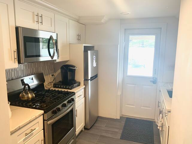 Full new kitchen, complete with Keurig and regular coffee makers, gas stove and all the utensils and pots and pans you will need.