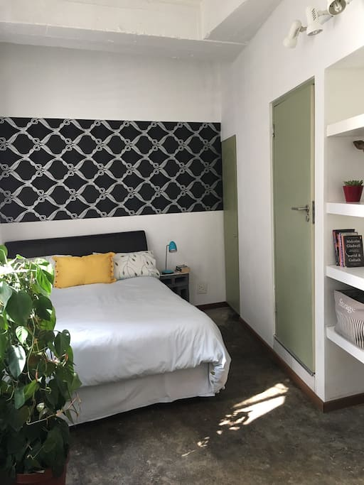 Comfortable double bed with leather headboard.