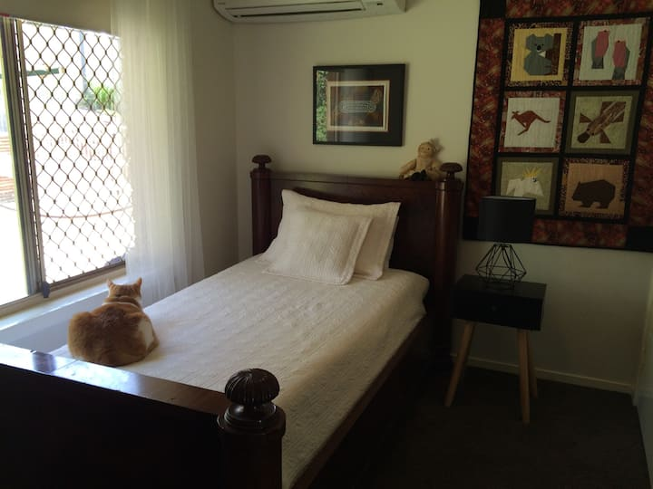 Antique Single Bed with Visiting Tabby Cat
