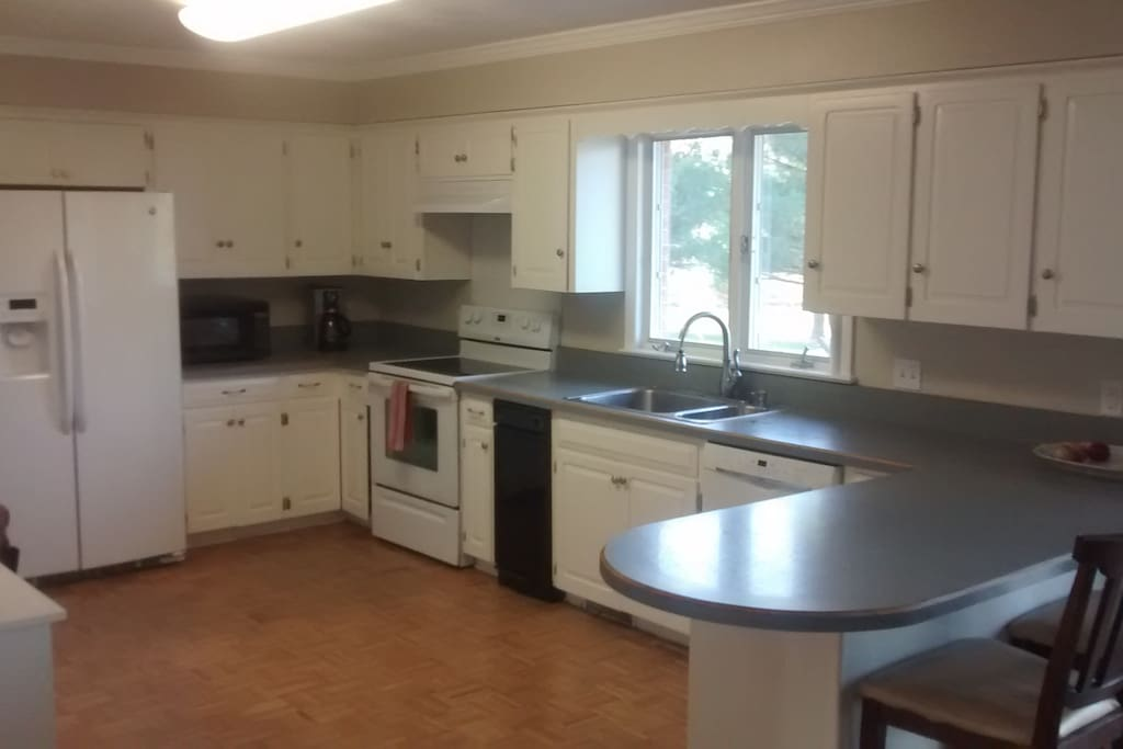 Full Kitchen, Stove, Microwave, Coffee Maker, Crock pot, Dishwasher, Toaster Oven, Trash Compactor