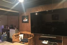 downstairs living room with kitchenette and TV