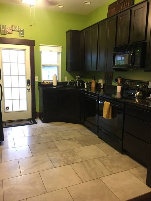Stocked kitchen (dish ware and cookware) with updated appliances.