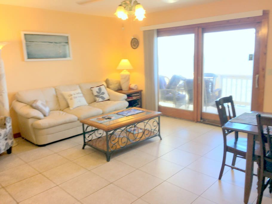 Living room, 8 foot sliding glass door to deck overlooking water, queen sleeper couch