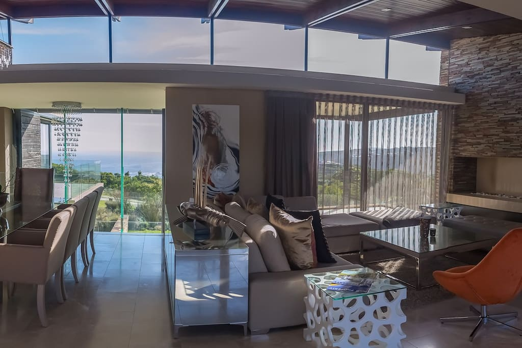 Sunlit open plan dining and living area with state-of-the are technology