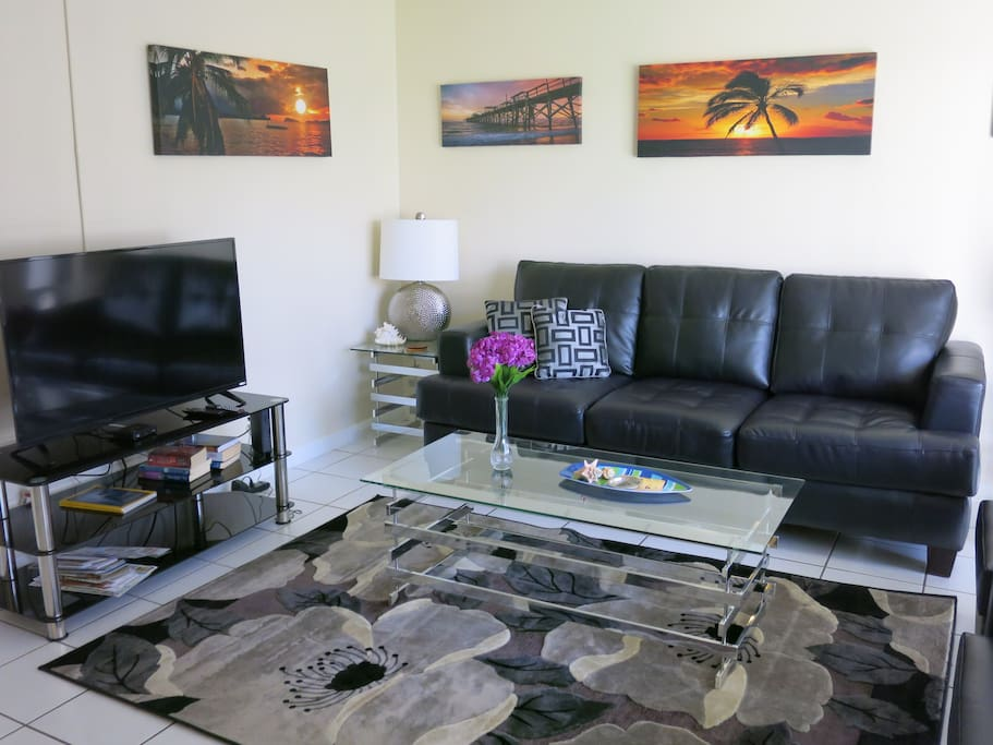 LIVING ROOM IS FURNISHED WITH CONTEMPORARY FURNITURE