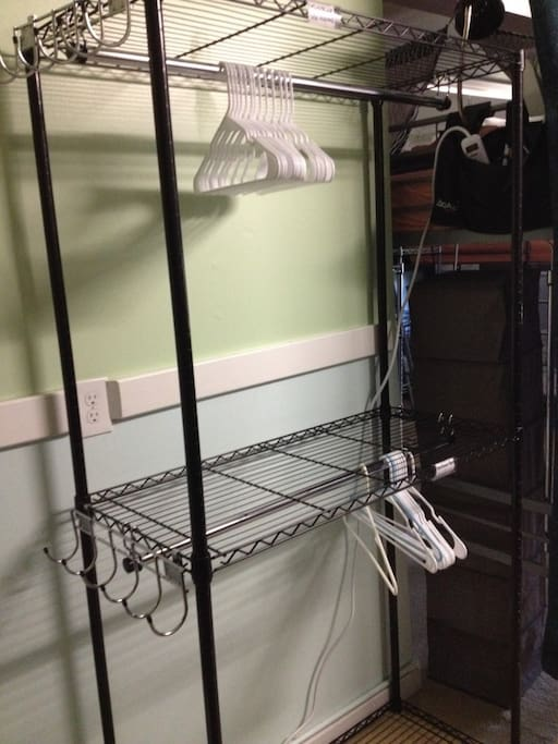 "Top bunks have reserved clothes hanging rack direct next to bed labeled ""TOP"""