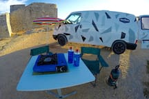 All you need is Included in the van. Kitchen, gas, table, chairs, parasol, shower, solar panel, and more