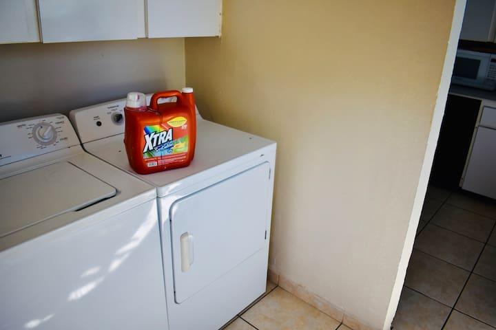Washer, dryer and detergent in the kitchen.