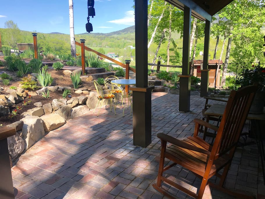Covered brick patio with mountain views
