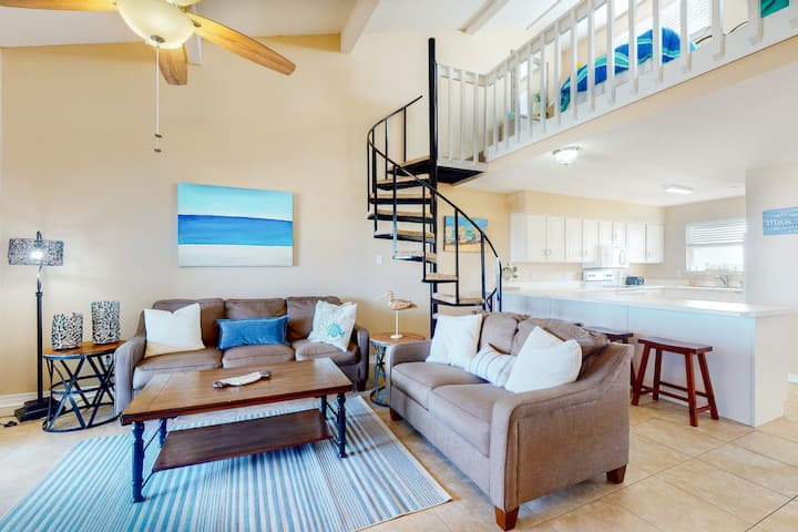 Waterfront condo w/shared outdoor pool, furnished balcony, & beach access