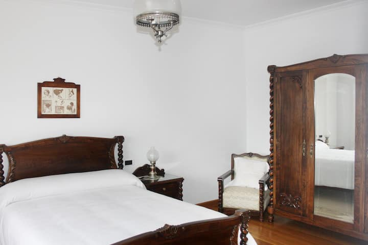 Suite luminosa años 20 con terraza y baño privado