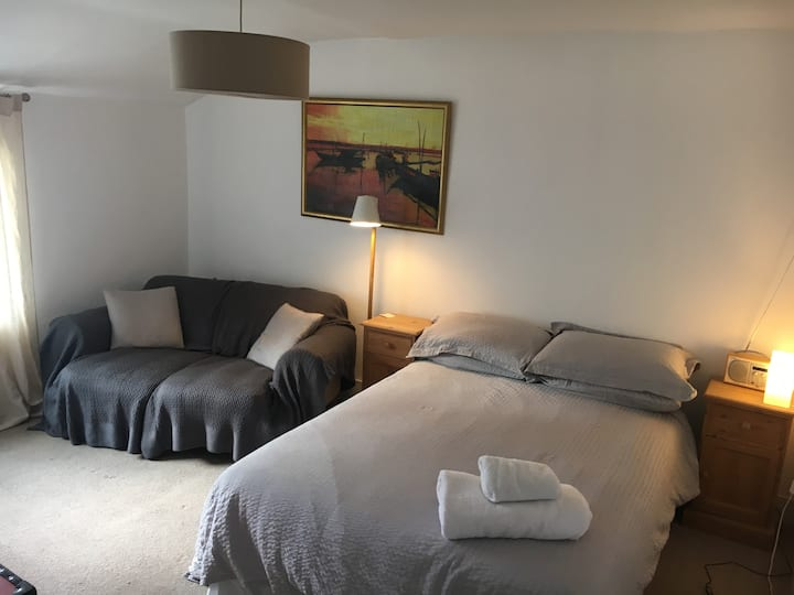 Large double bedroom with sofa