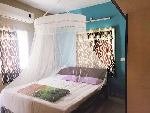 Bedroom 1 : Air-conditioning with King Size Bed , Attached Western toilet , Wardrobe , Mosquito net on all windows , Beautiful Mosquito net on Bed.