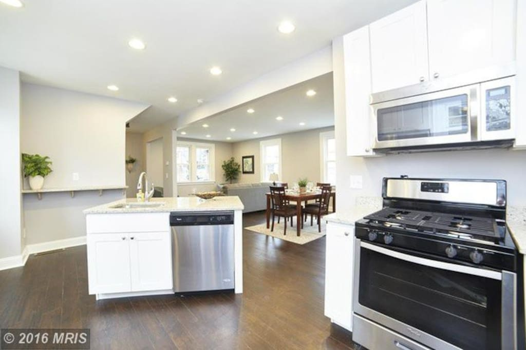 Brand new stainless steel appliances compliment this open floor plan