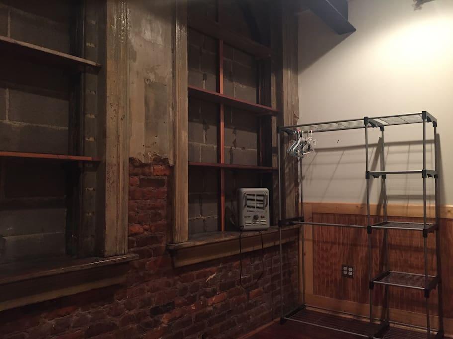 Bookshelves, heater, closet with hangers