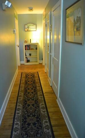 This is the hallway in the Cottage. There are 2 rooms on each side of the hallway.
