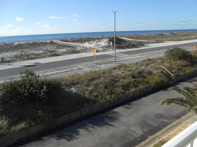 View of beach and gulf from front deck. Easy boardwalk access to beach.