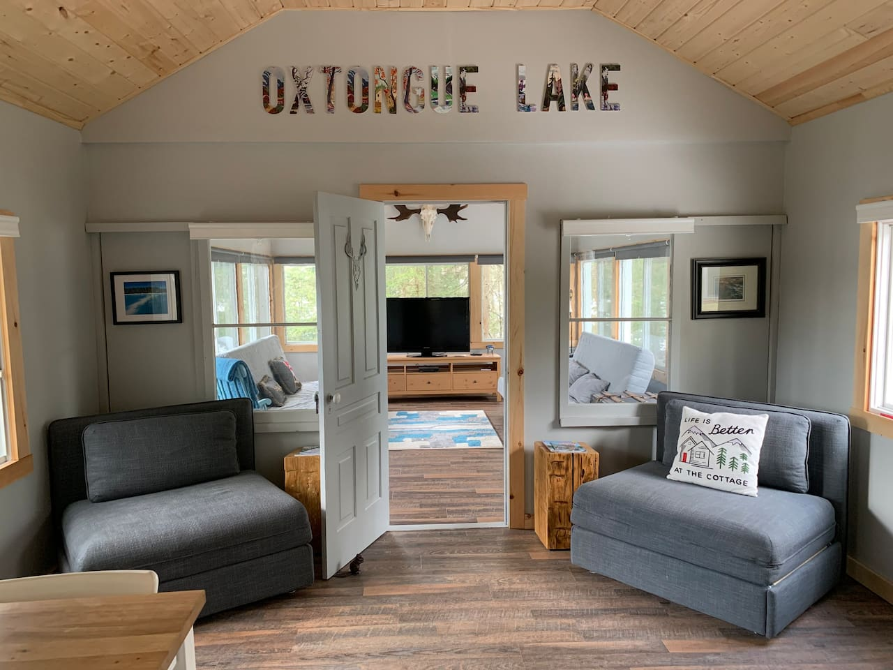 Welcome to Oxtongue Lake. The living room has 2 single chairs that pull out into single beds.
