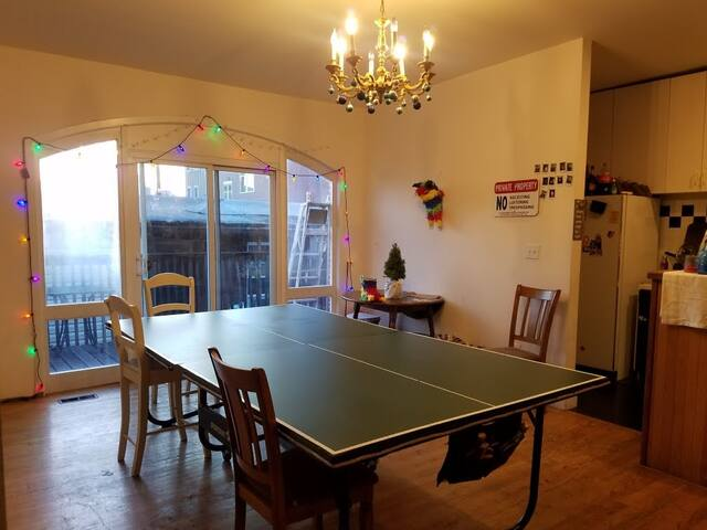 Large dining room table/ping pong table connected to the deck