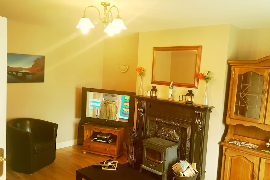 spacious living roon with solid cuel stove