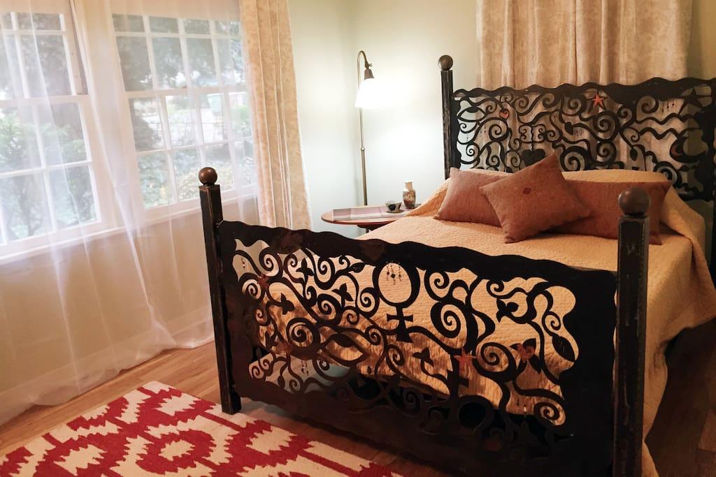Unique sculptural queen bed features Tempurpedic comfort.