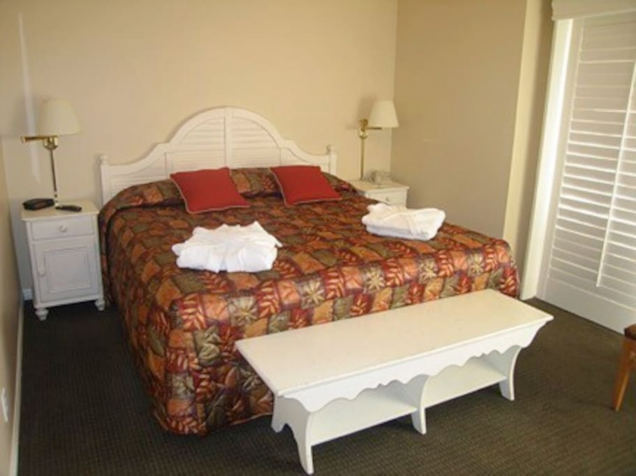 Master bedroom with king size bed.  Each bedroom has cable TV