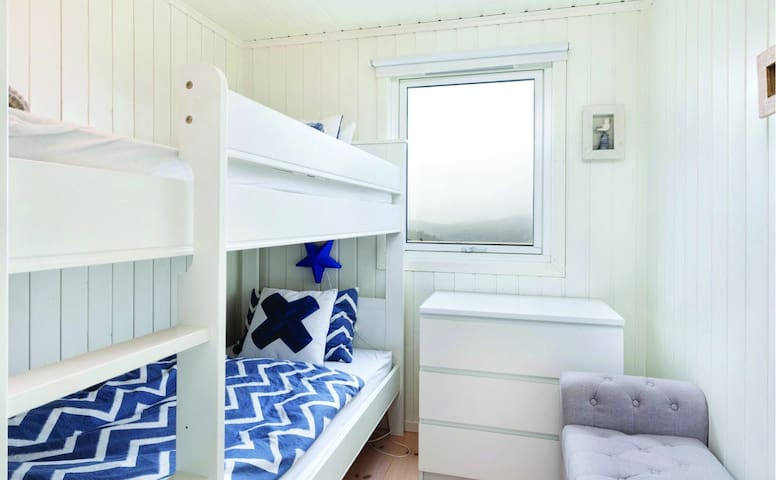 Bedroom with bunk beds offering views over the Skogsoy archipelago and North Sea.