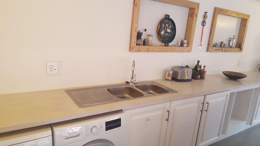 Kitchen with dishwasher and washing machine.