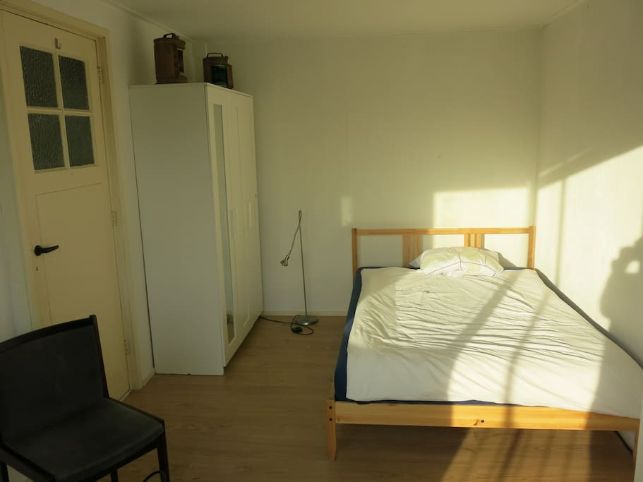 Private room with double bed, desk and closet