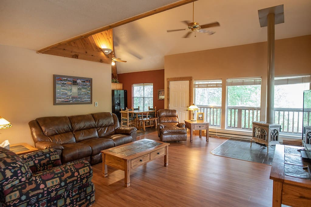 The vaulted ceilings, open floor plan, gas fireplace and natural light make the living room ideal for relaxing