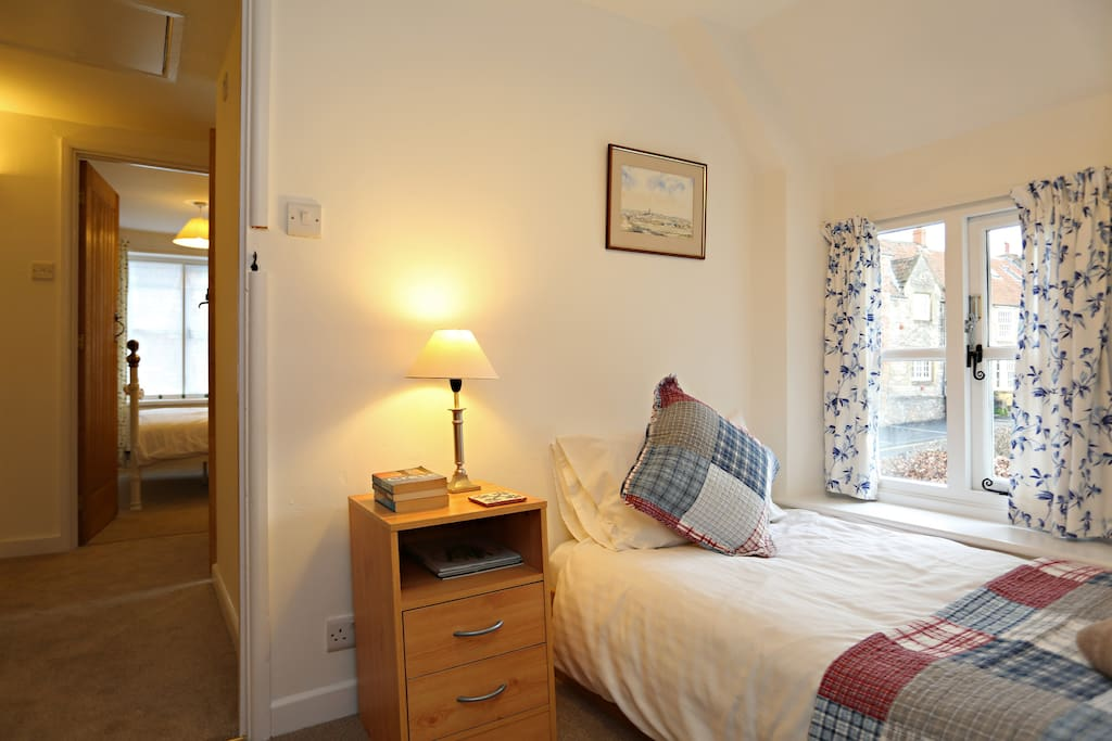 The second bedroom with single bed