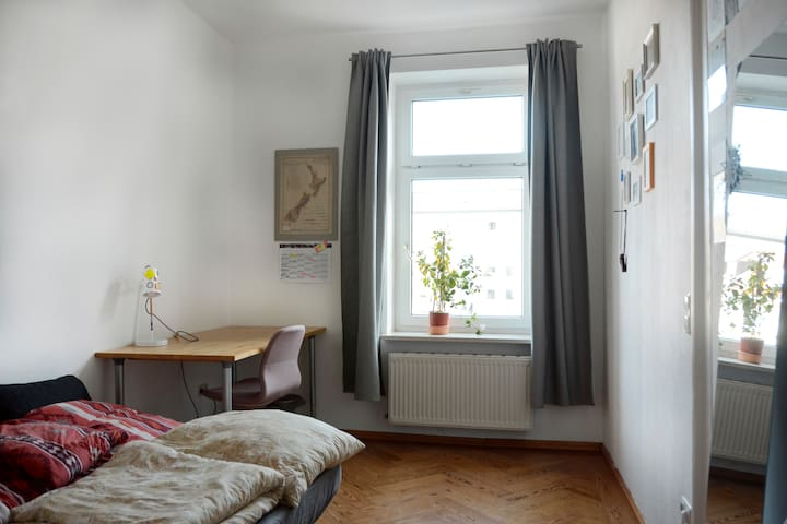 Heartwarming bedroom in a cozy old flat
