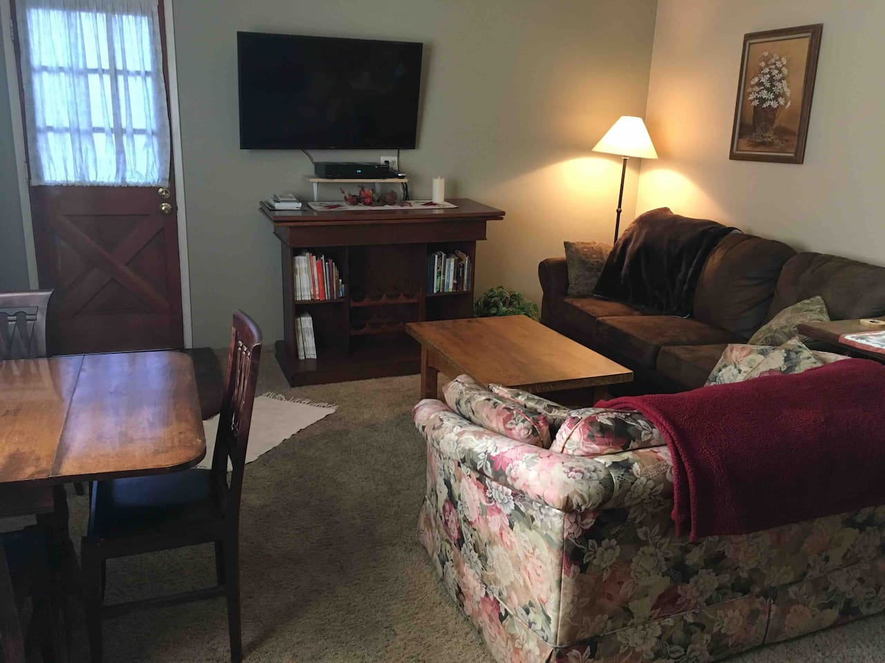 """Living Room & Dining Area with New Smart 48"""" Smart TV and DVR."""