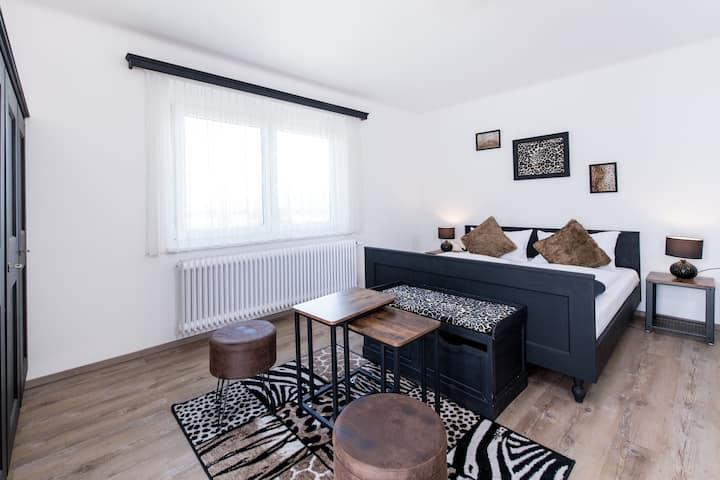 """Zimmer """"Savanne"""" mit Seeblick Gästehaus Margarethe"""
