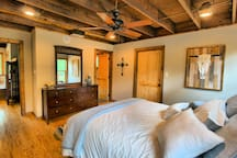 Master bedroom w/ direct access to bathroom and utility room with washer/dryer.