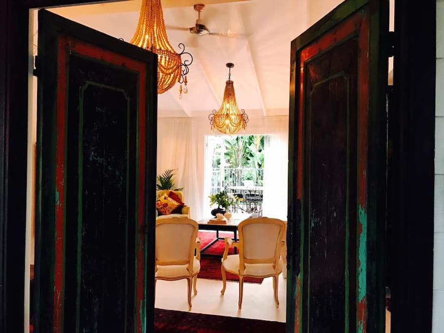 Walk into a Beautiful Elegant Room overlooking the lush tropical pool and gardens