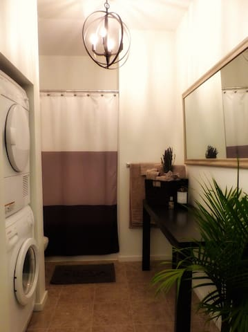 Large washroom with ensuite washer and dryer for your convenience. Future plans include a redesign to better reflect the character of the rest of the loft.