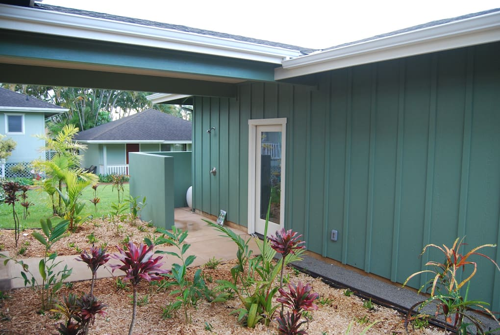 Covered walkway from garage and outdoor shower