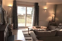 View from kitchen area across the room to patio door.