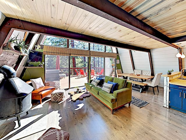 Double-height windows flood the main living area with light.