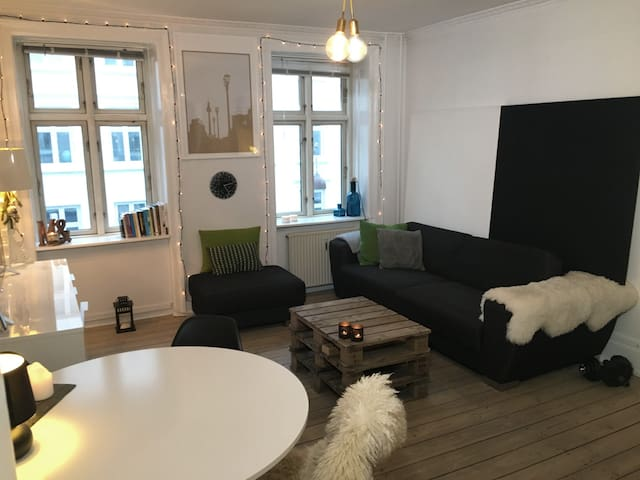 Living room with dining table and sofa with noise cancellation-boards behind