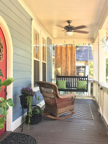 Enjoy coffee, conversation or the street promenade from the front porch