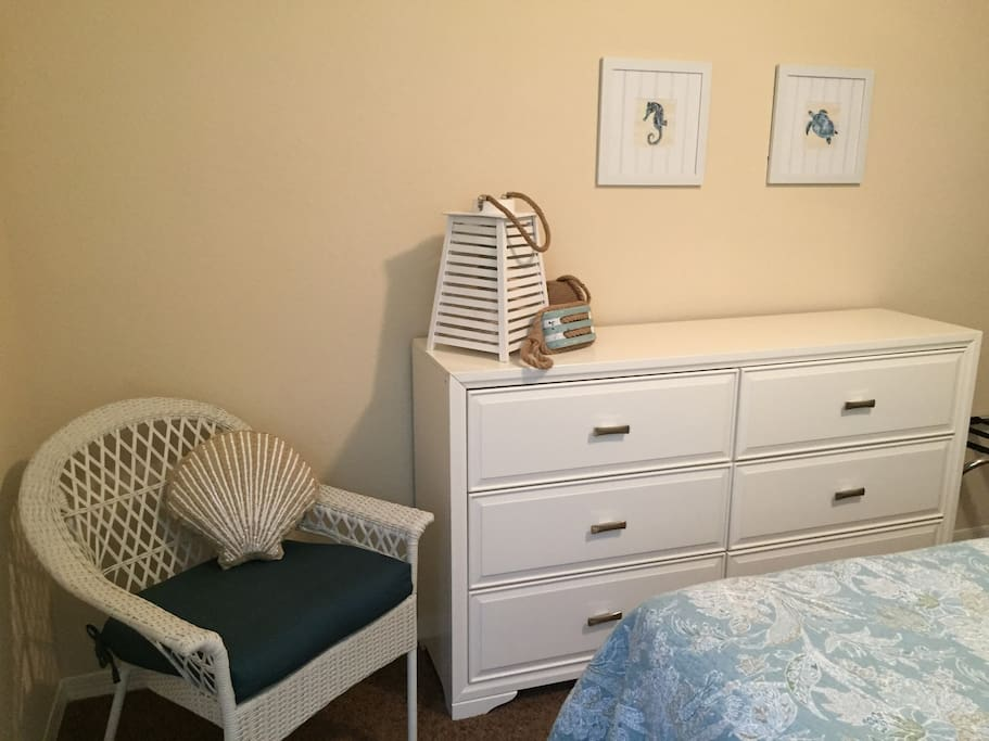 Small seating area for convenience.  For extended stay guests, dresser is available for your use.