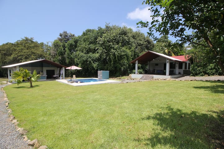 Just steps to the pool and guest house (which can be booked separately for larger groups).